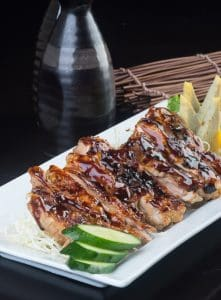 japanese cuisine. grilled chicken on background