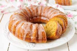 Pumpkin Bundt Cake with Sugar Icing on a White Plate
