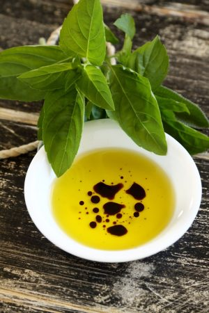 Dipping condiment of olive oil and balsamic vinegar with sage.